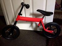 Kids red balance bike