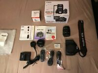 Canon 550D with kit lens, 50mm prime lens, 32GB SD card. BOXED+BAG+GRIP