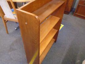 dark wood free standing book shelf.