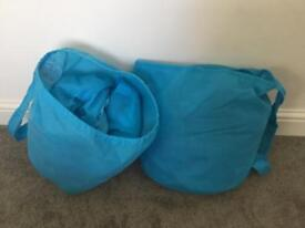 2 blue air beds with sleeping bag attached