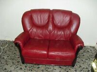 Red Leather Electric recliner and matching two seater settee