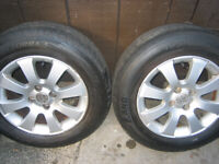 cheap set of vauxhall astra alloys with excellent tyres