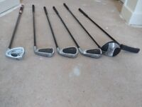 Six junior golf clubs in bag with selection of golf balls