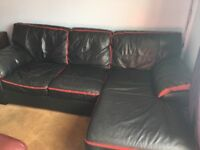 Leather black sofa with black trim with an extended seat
