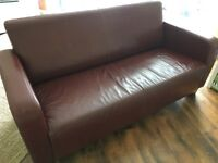 Leather sofa and leatherette coffee table for sale
