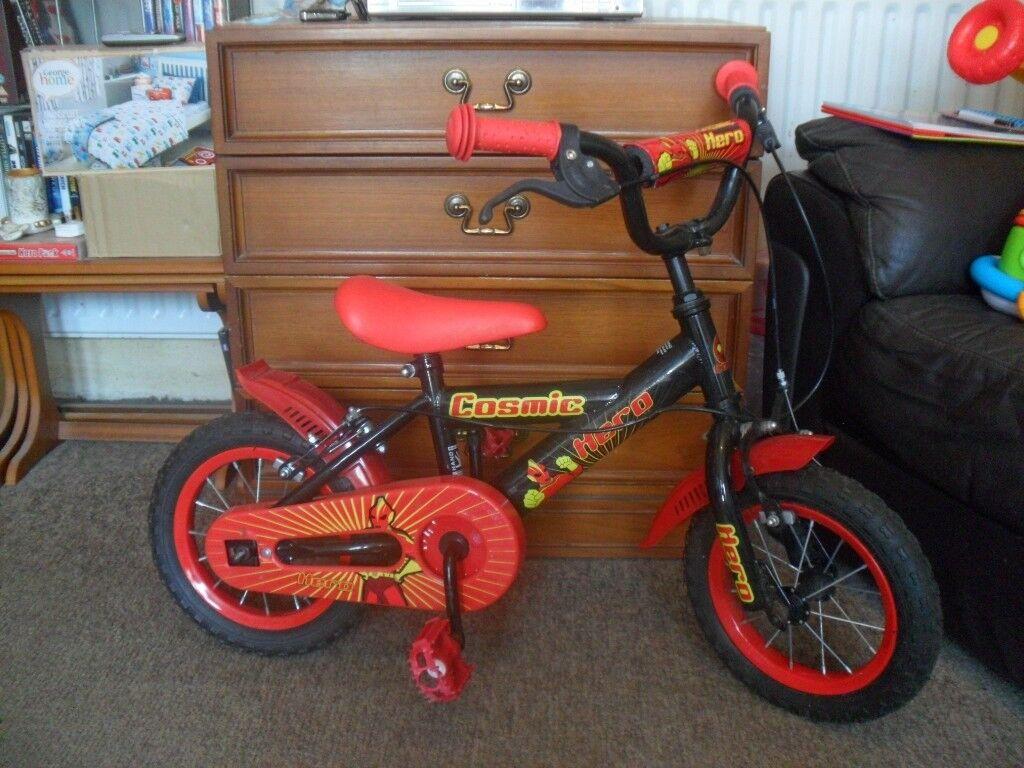 Boy's red and black bike