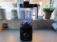 Phillps food blender hardley used crushes ice no longer need color black good for smoothes as well