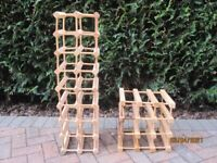 Wooden Wine Racks. 1 holds 16 bottles, 1 holds 9 bottles. Can be reconfigured to other shapes