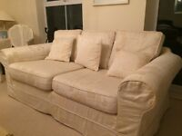 Cream 3 seater sofa.
