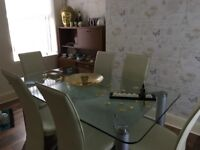 Double glass table and 6 chairs