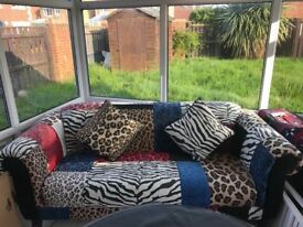 DFS Animal print patchwork sofa and foot stool
