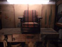 Vintage 1950's club chair in original worn leather handmade kilim upholstered seat and back oak