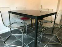 Ikea smoke glass dining table and chairs