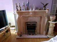 Marble fire suround and electric fire