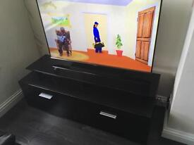 Samsung slim 50inch T.V and black T.V unit