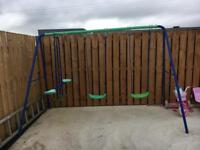 Double swing set with glider see-saw