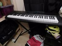 Casio CTK-1200 (With free stand)