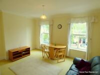 A specious and very bright first(top) floor converted flat very well-presented with separate Kitchen