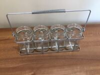 New and unused hanging herb planter or Set of 4 glass jugs with handles in metal carrying container