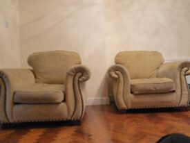 Two fabric armchairs.