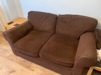 Two brown 2 seater sofas