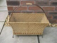 A wicker paper/ magazine rack.