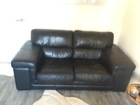 2 black Italian leather sofas