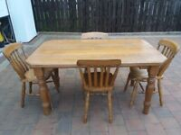 chestnut dining table with 4 chairs. Custom made. Good Condition