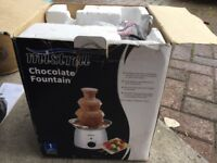 Chocolate fountain never used still in box...box slightly damaged tho