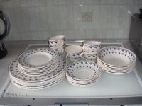 Used set of dinner plates, tea plates, cups, saucers and bowls