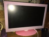 Small pink TV with built in DVD, ideal for child's bedroom
