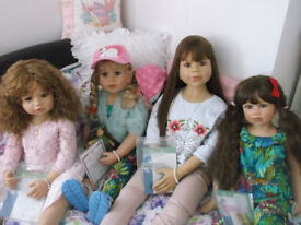 four collectable masterpiace dolls