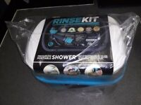 Brand new Rinsekit potable pressurised shower unit.No batteries or pumping needed.