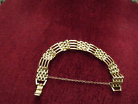 gold coloured gate bracelet
