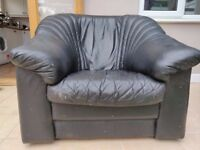 2 black faux-leather armchairs