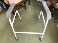 Adjustable toilet frame