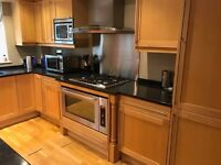 A complete shaker style kitchen with solid granite worktops and including appliances.