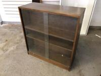 Glass fronted wooden bookshelves with rear hidden compartments