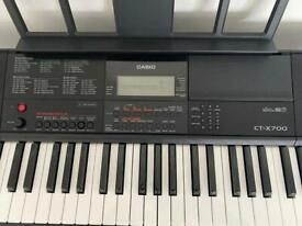Casio CT X700 Portable Keyboard with a stand