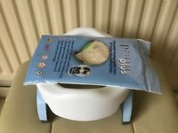 Travel potty and child changing bag