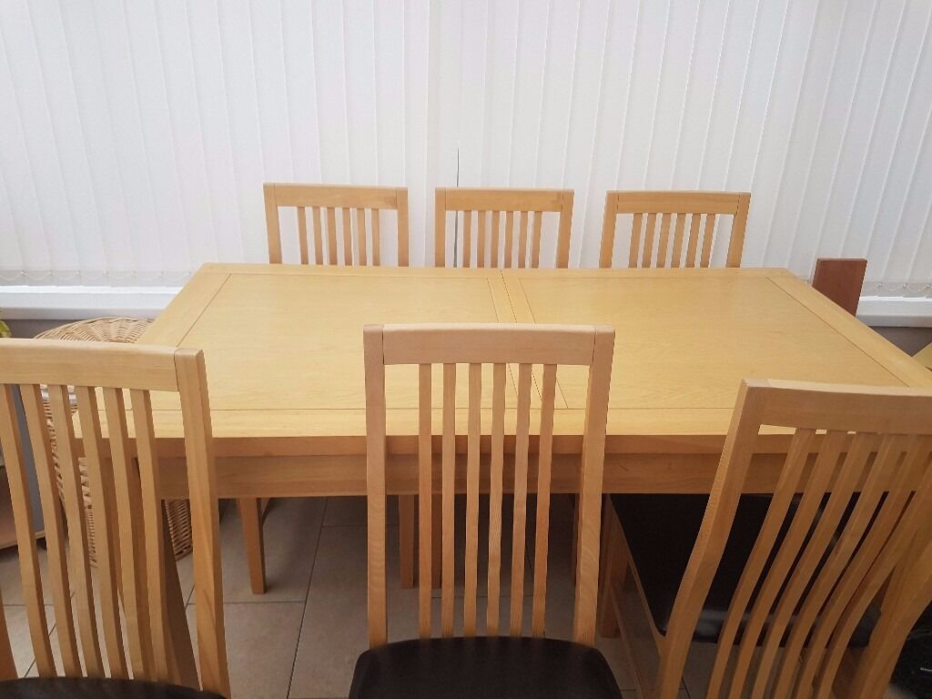 lovely dining table with six chairs hardly used