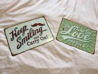 2 metal quote signs