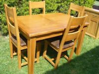 CAN DELIVER - GREAT QUALITY SOLID OAK EXTENDING DINING TABLE AND 4 LADDER BACK CHAIRS IN V.G.C
