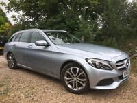 Hybrid, electric-diesel, silver-blue sports estate, immaculate condition.