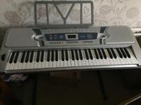 61 Key silver electronic piano with stand with original packaging