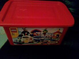 Large red box of lego bricks