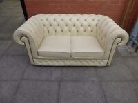 A White Leather Chesterfield Two Seater Sofa