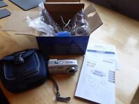 Olympus 6mp digital camera in good condition, with original packaging