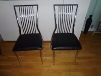 2 chrome and black dining chairs