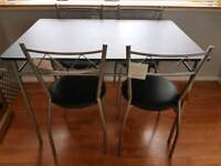 Brand new black table and 4 chairs